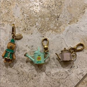 Three Juicy Couture charms.